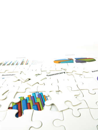 Missing jigsaw puzzle pieces on Graph Calculations background, Key for Business economic success concept.