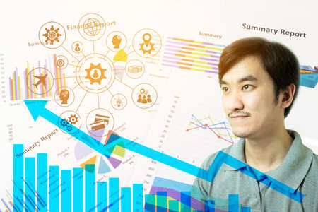 Double exposure of young Asian man thinking with Chess board versus Finance graph chart, Financial strategy concept, Business concept. Stock Photo