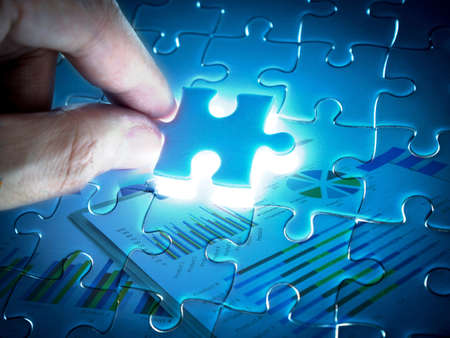 Double exposure of Missing Jigsaw puzzle piece with lighting, business concept. Imagens