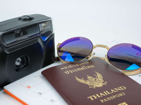 Travel concept with accessories and passport isolated on white background.