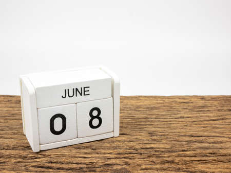 June 8 white cube wooden calendar on vintage wood and white background with Summer day, Copyspace for text, World Oceans Day.