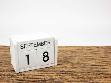 September 18 white cube wooden calendar on vintage wood and white background with autumn day, Copyspace for text.
