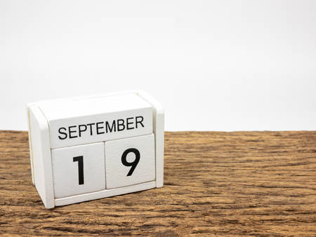 September19  white cube wooden calendar on vintage wood and white background with autumn day, Copyspace for text.