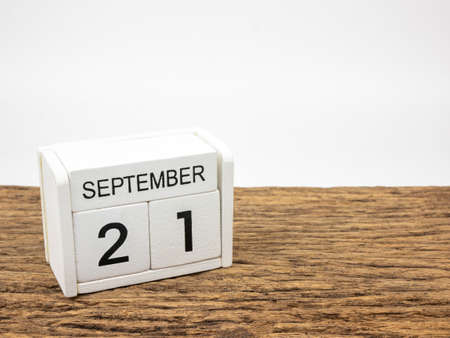 September 21 white cube wooden calendar on vintage wood and white background with autumn day, Copyspace for text, International Peace Day.