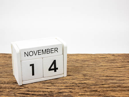 November 14 white cube wooden calendar on vintage wood and white background with autumn day, Copyspace for text. Foto de archivo