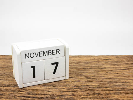 November 17 white cube wooden calendar on vintage wood and white background with autumn day, Copyspace for text. Foto de archivo