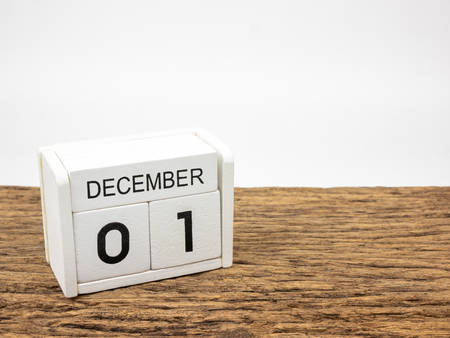 December 1 white cube wooden calendar on vintage wood and white background with winter day, Copyspace for text, World AIDS Day. Imagens