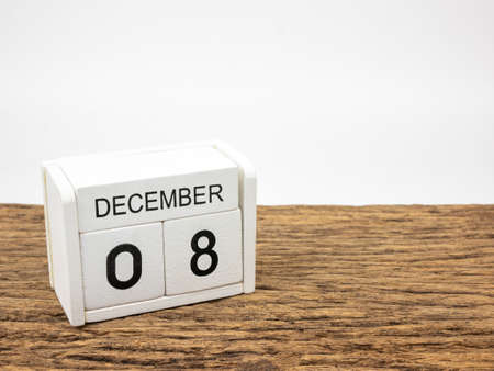 December 8 white cube wooden calendar on vintage wood and white background with winter day, Copyspace for text.