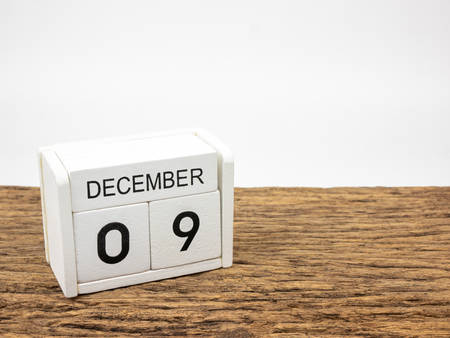 December 9 white cube wooden calendar on vintage wood and white background with winter day, Copyspace for text, International Anti-Corruption Day.