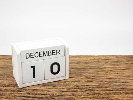 December 10 white cube wooden calendar on vintage wood and white background with winter day, Copyspace for text, Human Rights Day.
