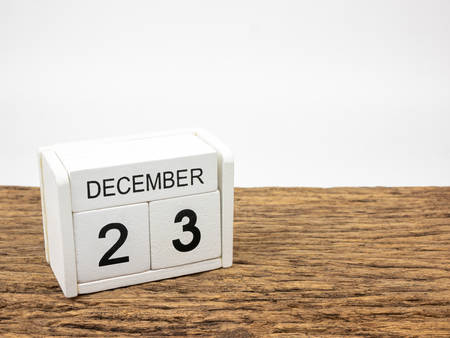 December 23 white cube wooden calendar on vintage wood and white background with winter day, Copyspace for text. Imagens