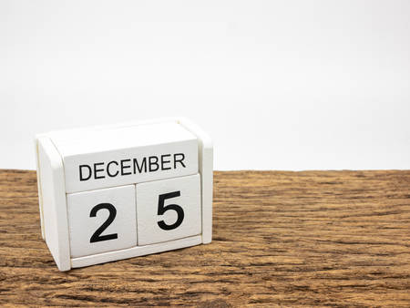 December 25 white cube wooden calendar on vintage wood and white background with winter day, Copyspace for text, Christmas day.