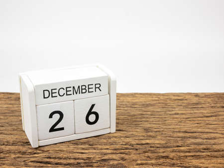 December 26 white cube wooden calendar on vintage wood and white background with winter day, Copyspace for text.
