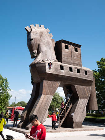 CANAKKALE, TURKEY - May 30, 2019: Replica of wooden Trojan horse in ancient city Troy. It is tale from the Trojan War about the subterfuge.