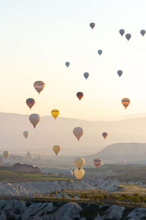 Colorful Hot air balloon flying over Red valley at Cappadocia, Anatolia, Turkey. Volcanic mountains in Goreme national park.