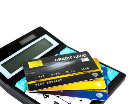 Credit card on calculator isolated on white background.