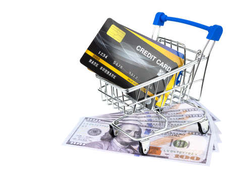 Credit cards and american dollars cash with small shopping cart isolated on white background.
