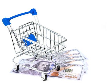 American dollars cash with small shopping cart isolated on white background.