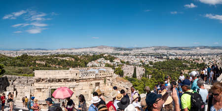 ATHENS, GREECE JULY. 30, 2019 The Acropolis of Athens is the most visited monument of antiquity in Greece with Athens city background.