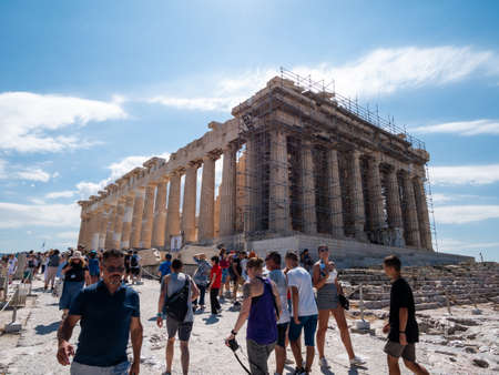 ATHENS, GREECE JULY. 30, 2019 The Acropolis of Athens is always crowded - this is the most visited monument of antiquity in Greece. Редакционное