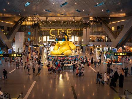 DOHA, QATAR - MAY. 31, 2019: Yellow Lamp bear at Hamad International Airport.
