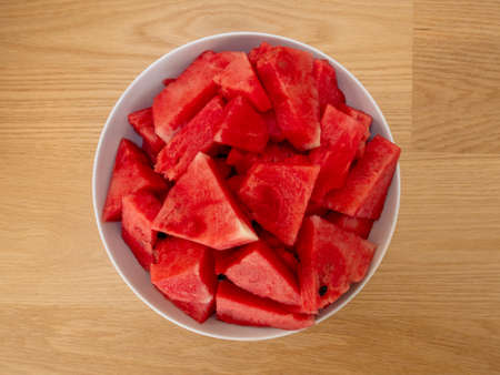 Cube slices of a ripe watermelon on a plate. Selective focus.