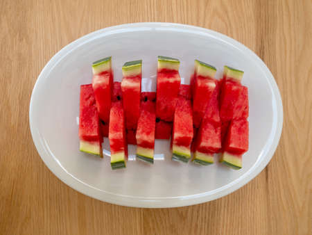 Slices of a ripe watermelon on a plate, Selective focus.