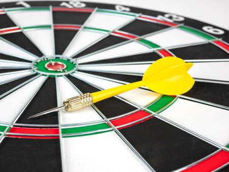 Yellow Dart arrows and dartboard.
