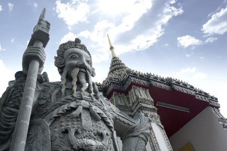 Ancient warrior statue at Wat Pho in Thailand. Editorial