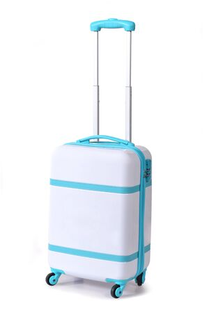 One light blue suitcase for travel or light blue luggage, light blue baggage isolated stand alone on white background with clipping path.