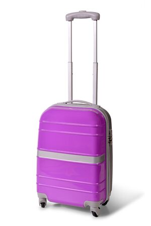One pink suitcase for travel or pink luggage, pink baggage isolated stand alone on white background Stock Photo