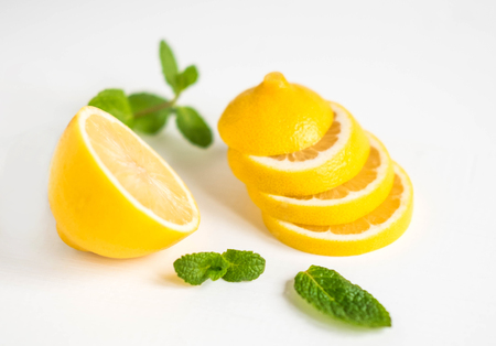 Lemon with mint on a white background. Healthy food products. Vitamin C. Banco de Imagens