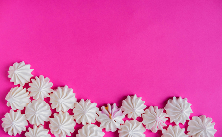 Frame for backing with a meringue on a pink background. Basis for design with multicolored meringues on a pink background.