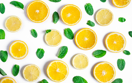 Orange and lemon slices with mint on a white background. Background for the design of banners, websites, blogs, information block. Banner with orange and lemon. Imagens