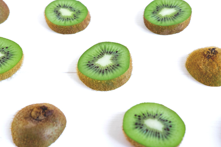 Background for the profile, design, printing with fruit. Fresh kiwi sliced. The basis for the banner with kiwi. Healthy food Фото со стока