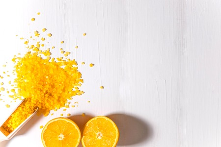 Bath salt with the smell of orange and oranges. Fragrant bath salts. The basis for the banner, flyers, advertisements with cosmetic products.