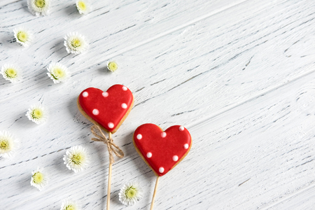 Hearts on a white wooden background. Background for Valentine's Day. Background for a banner with hearts for girls.