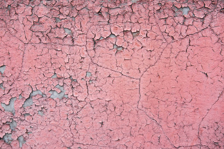 The texture of the concrete wall from which the paint peeled off.