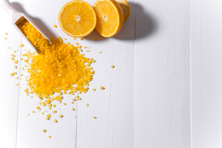 Bath salt with the smell of orange and oranges. Fragrant bath salts. The basis for the banner, flyers, advertisements with cosmetic products. Background for spa salons.