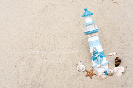 Sea banner with lighthouse and shells on sand. Blank for postcard or tourist banner.