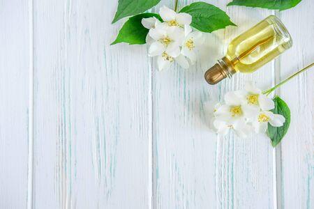 Photo of jasmine oil. Jasmine flowers and oil. Photo cosmetology