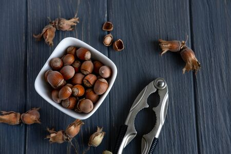Hazelnuts on a light background. Healthy nuts. Fruits of a forest shrub, hazel