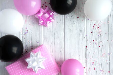 Party banner. Frame for text with balloons in a circle, bows and a pink gift box. Birthday Greeting Card