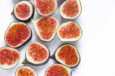Sliced figs on a light background. Healthy fruits. Nutrition with diet, vegetarianism, healthy nutrition.
