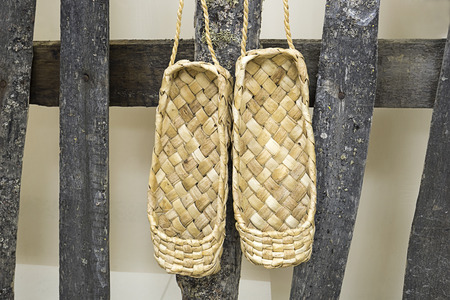 wicker work: Shoes lacovia hang on the fence Stock Photo
