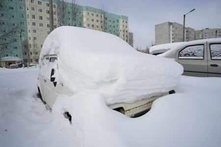 abandoned car: In the urban yard of an abandoned car. Stock Photo