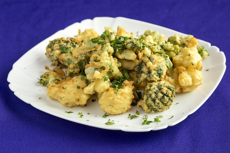 Broccoli,fried in batter and sprinkled with herbs.