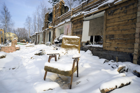 lowrise: Old chair covered with snow in a ruined house .