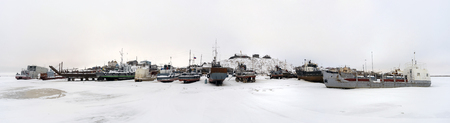 taz: Fishing boats at rest on stands on the shore.