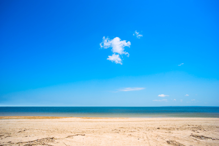 Sandy beach and cloud on blue sky .The Crimea ,Azov sea.